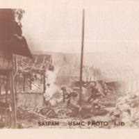 Marines in battle, destroyed houses