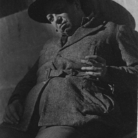 [Portrait of Diego Rivera, seated, wearing hat, right…