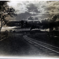 Railroad track with approaching train