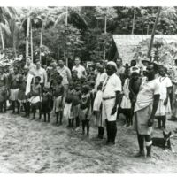 Natives of Solomon Island Posing with Seabees from 14th…