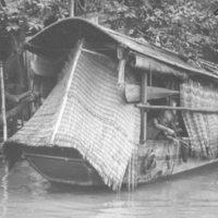 097. Sampan in rain and child, Pearl River