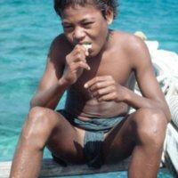Boy Eating on Canoe