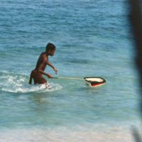 Boy with Toy Boat in Water