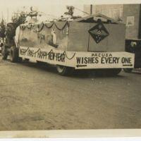 Kaizawa 3-010: Chrismas parade float with a sign that…