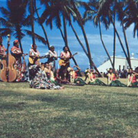 Pounding poi, aquarium in background. Hono. 8 Apr. 1954