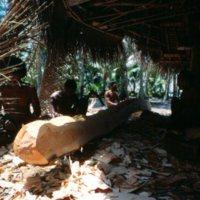 Men Adzing a Log