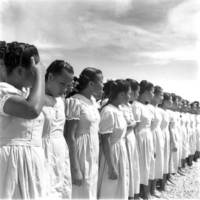 Young women at graduation. (NO-3106.01).
