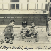 """Two Japanese boys and one girl playing on """"goza (a…"""