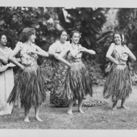 Three Women Performing Hula with 2 musicians