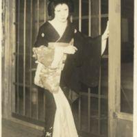 Kaizawa 1-119: Kabuki actor as a woman standing in…