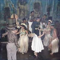 Hula dancers dancing with tourists