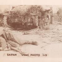 Dead Japanese soldier in front of tank