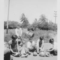 [076] Children Opening Coconuts
