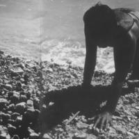 Girl on rocky shore