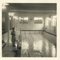 Aileen Kerrigan standling by a swimming pool, Japan