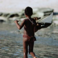 Boy with Toy Canoe