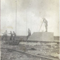 Workers Pulling Cables with Surveyor