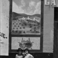 Two children with pulqueria mural