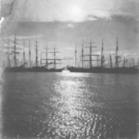 6 or more masted sailing ships anchored in harbor