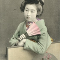 [A woman in kimono holding a folding fan in her hand]