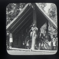 Villagers in large pavilion with slit gong drum