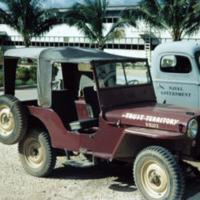 Red-maroon jeep. Ad. Bldg. ComMar. Guam. Dec. 1949