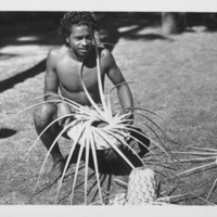 Boy Making Coconut Frond Woven Hats