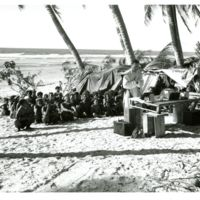 U.S. Marines with natives on Fais Island, Ulithi Atoll…