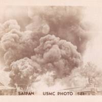 Smoke billows up from explosion, houses in foreground