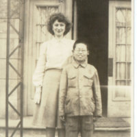 Aileen Kerrigan and a bespectacled Japanese boy posing…
