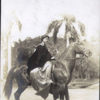 Woman  on a horse wearing pa'u (long skirt…