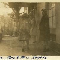 Mrs. Allman, Mrs. & Miss Rogers standing on a street,…