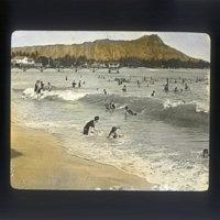 Bathers frolicking at Waikiki Beach