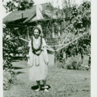 [115] Woman in Hula Costume and Lei in Garden