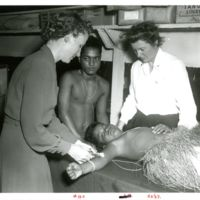 Navy nurses give a yaws injection to a Micronesian…