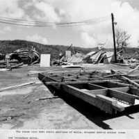 Debris around telephone pole. (N-1886b.06).