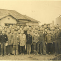 A group of Japanese boys with their teachers at the…