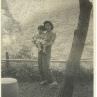Chizuko Miyanoshita, a house maid, holding a Japanese…