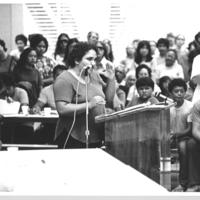 Female speaker at podium