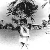 Young Boy with flag at Melekeok Field Day. (N-2219.12).