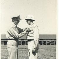 Brigade General Ferrin decorating 1st Lt. Walter Deppe…