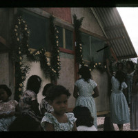 Close-up shot of the Kili women decorating Kistes's…