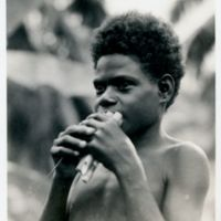 [Boy with reed flute]