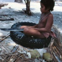 Young Boy Sitting in a Tire - 1
