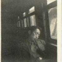 Kaizawa 2-042: Freddie Yoshida asleep on a train,…