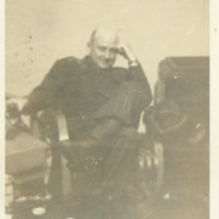 Emery Middleton relaxing in an arm chair