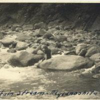 Aileen Kerrigan dipping her feet in mountain stream,…