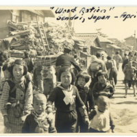 Wood ration cart in street with many Japanese children…