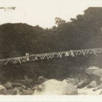 Three people on a bridge over a stream, Miyanoshita…