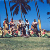 Dancers eating taro. 8 Apr. 1954